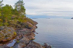 Granite rocks on the shore of Lake Ladoga. Stock Images