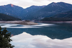 Ladonas artificial lake in Greece with mountains as background Royalty Free Stock Images
