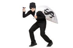 Ladrão com um saco e lanterna elétrica nas mãos Foto de Stock Royalty Free