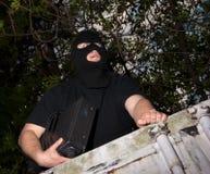 Ladrão em uma máscara fotografia de stock royalty free