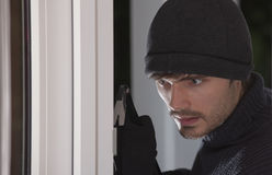 Ladrón con la palanca foto de archivo