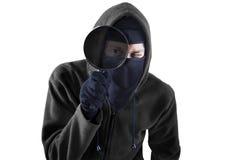 Ladrón con magnificar aislado Imagen de archivo libre de regalías