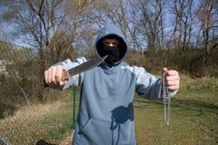 Ladrón con un cuchillo Fotografía de archivo