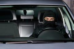 Ladrón emocionado con el nuevo coche Fotos de archivo libres de regalías