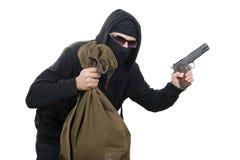 Ladrón encapuchado con el bolso del dinero imagen de archivo libre de regalías