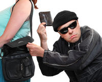 Ladrón que roba del bolso. Imagenes de archivo