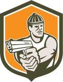 Ladrón que señala el escudo del arma retro Foto de archivo libre de regalías