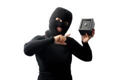 Ladrón que sostiene una caja fuerte fotografía de archivo libre de regalías