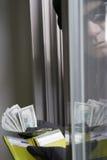 Ladrón Stealing Money Imágenes de archivo libres de regalías