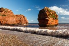 Ladram Bay Devon England UK. Dramtic red Jurassic cliffs at Ladram Bay Devon England UK Europe stock images