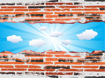 Ladrillo rojo de Grunge con el cielo azul Fotos de archivo