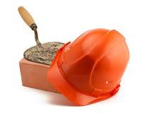 Ladrillo rojo y paleta del casco anaranjado Imagen de archivo