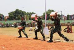 Ladrillo roto acción TNI indonesio Foto de archivo