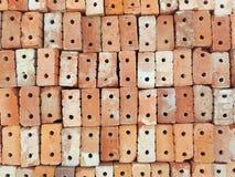 Ladrillos anaranjados de la arcilla usados para la construcción Fotografía de archivo libre de regalías