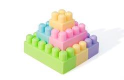 Ladrillos del juguete de la dimensión de una variable de la pirámide Imágenes de archivo libres de regalías