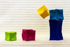 Ladrillos del juguete que caen abajo Fotografía de archivo libre de regalías