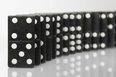 Ladrillos negros del dominó Imagenes de archivo