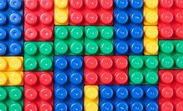 Ladrillos plásticos coloridos Imagenes de archivo