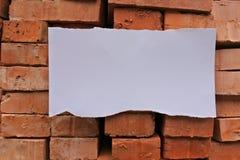 Ladrillos y un papel Imagen de archivo