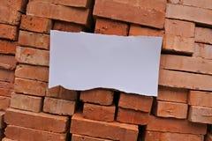 Ladrillos y un papel Fotografía de archivo libre de regalías