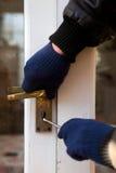 Ladrón romper-en seguridad del robo con allanamiento de morada Imagen de archivo