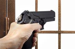 Ladro armato con una pistola Fotografie Stock Libere da Diritti