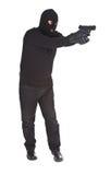 Ladro che mira con la sua pistola Fotografia Stock