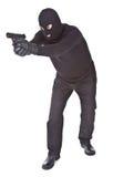 Ladro che mira con la sua pistola Fotografia Stock Libera da Diritti