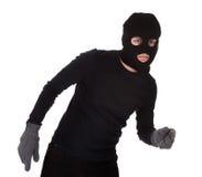 Ladro che porta una balaclava Immagini Stock