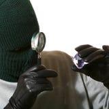 Ladro con il magnifier ed il gioiello Fotografia Stock Libera da Diritti