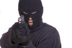 Ladro con la pistola fotografie stock