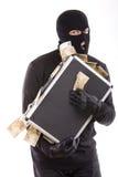 Ladro con soldi Fotografie Stock Libere da Diritti