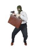 Ladro con una pistola e una valigia in pieno di soldi Immagini Stock