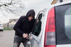 Ladro di automobile, furto di automobile Fotografie Stock Libere da Diritti