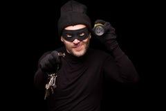 Ladro mascherato Immagini Stock