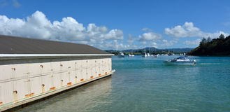 Ladscape view of an old boat shed in Sandspit New Zealand Royalty Free Stock Image