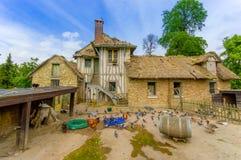 Ladugård i Hameau de la Reine, drottningens Hamlet Arkivfoton