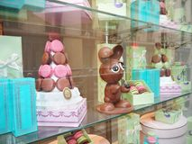Ladurée Easter Bunny Printemps Haussmann Paris. Window display with Ladurée macarons and a chocolate Easter Bunny. Printemps Haussmann department store stock images