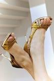 Lady's feet on high heel Stock Image