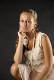 Lady. There is young lady looks at you. She wears old style dress royalty free stock image