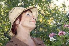 Lady 65 years old in the garden. Successful lady 65 years old with in the garden and see up Royalty Free Stock Images
