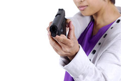 Lady in action pose as she aims a weapon through site.  Isolated Royalty Free Stock Photography