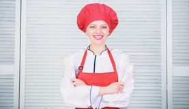 Lady adorable chef teach culinary arts. Professional culinary tips. Culinary show concept. Woman pretty chef wear hat. And apron. Delicious and easy recipes royalty free stock photography
