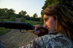 Lady aiming shotgun Stock Photography