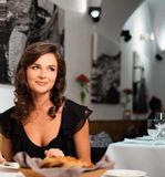 Lady alone in restaurant Royalty Free Stock Photo