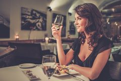 Lady alone in restaurant Stock Images