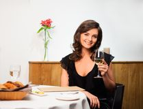 Lady alone in restaurant Royalty Free Stock Photography
