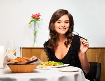 Lady alone in restaurant Stock Image