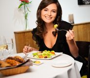 Lady alone in restaurant Stock Photo