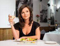 Lady alone in restaurant Royalty Free Stock Images